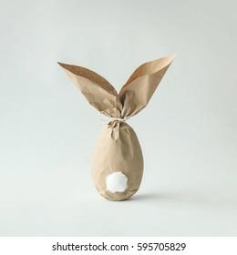 イースターバニー紙ギフト卵ラッピングdiyアイデア。最小限のイースターのコンセプト