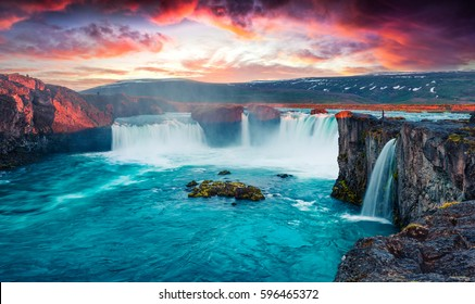 Unbelievable summer morning scene on the Godafoss Waterfall. Colorful sunrise on the on Skjalfandafljot river, Iceland, Europe. Beauty of nature concept background.