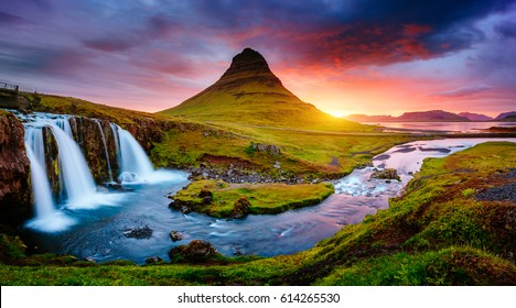 Kirkjufell volcano the coast of Snaefellsnes peninsula. Picturesque and gorgeous scene. Location Kirkjufellsfoss, Iceland, sightseeing Europe. Breathtaking picture of the popular tourist attraction.