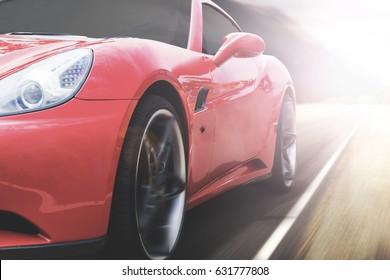 Panning shot van een mooie rode sportwagen versnellen op een snelweg met bewegingsonscherpte
