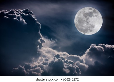 Nature background. Attractive photo of night sky with cloudy and bright super moon. The moon were NOT furnished by NASA.