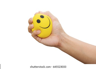 Apriete a mano la bola amarilla de estrés, aislada sobre fondo blanco, manejo de la ira, conceptos de pensamiento positivo