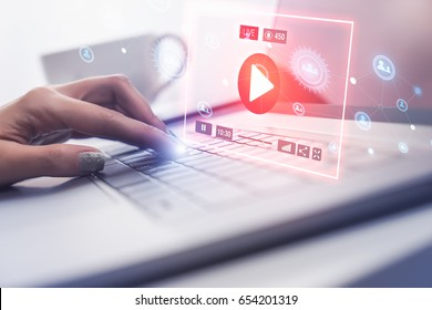 Woman hand using modern laptop computer to connect with live streaming video on social network