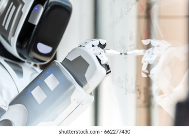 Smart robot is standing against transparent board