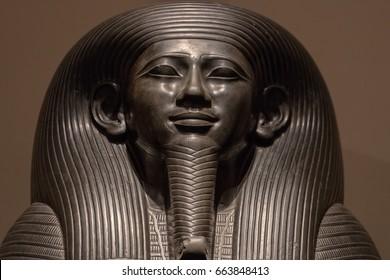 Pharaoh egyptian gods dead religion symbol stone statue isolated on black