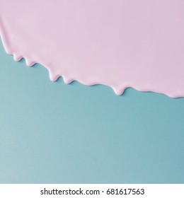 Abstract pink oil paint texture on blue canvas. Minimalistic background with copy space.