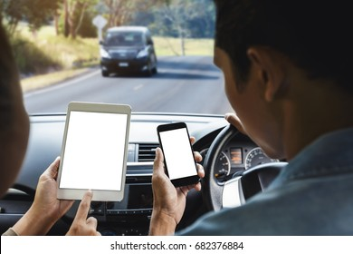 couple using phone inside car on rural road mobile app concept
