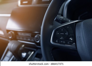 interior view of communication button on steering wheel of modern car