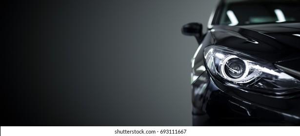 黒の背景に黒の現代車のクローズアップ。