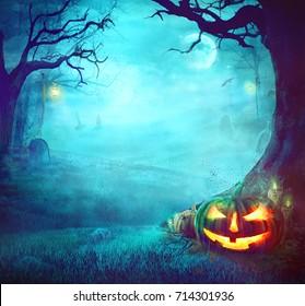Halloween Pumpkin in Dark Forest. Halloween Background. Halloween Pumpkin with Graveyard