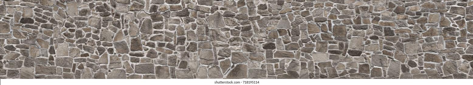 石垣の質感。古い城の石の壁のテクスチャの背景。背景またはテクスチャとしての石の壁。背景やテクスチャ用の石壁の一部