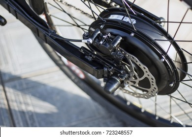 Close up of motor electric bike. Ebike bicycle environmentally friendly eco e-mountainbike transport. Healthy lifestyle