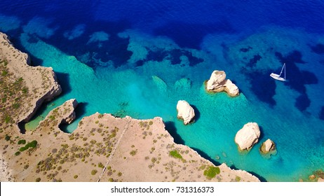 Aerial birds eye view photo taken by drone depicting beautiful deep blue turquoise waters and lovely rocky seascape in Glaronisi islet, Koufonisi island, Cyclades, Greece