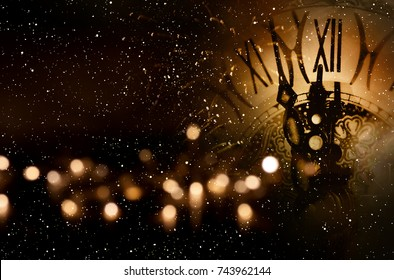 Background with clock and bokeh for new year congratulations