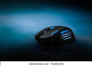 High technology computer gaming mouse : Professional wireless Game Mouse on dark blue  background ; hight contrast