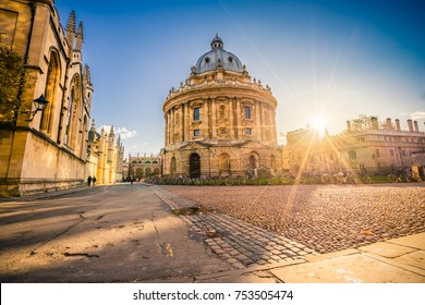 Radcliffe square with Science Library and sunset flare in Oxford, England