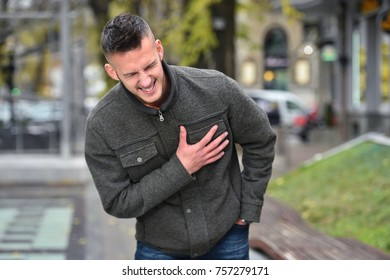 young man hearth attack in autumn