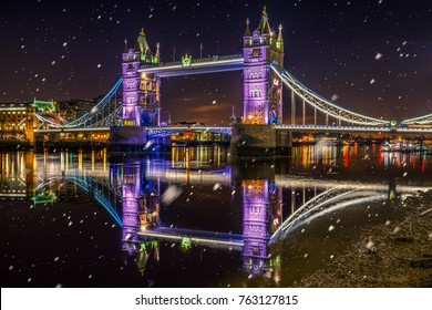 Tower Bridge with Christmas lights and falling snow