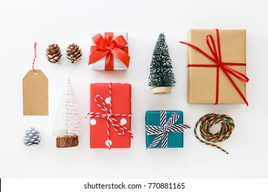 Gift box collection and christmas decoration on white background flat lay