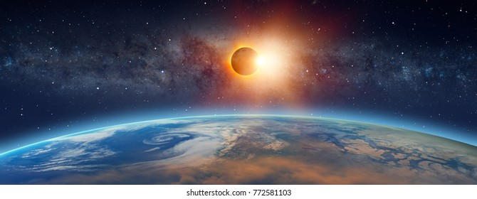 """Solar Eclipse  in front of the Milky Way galaxy """"Elements of this image furnished by NASA """""""