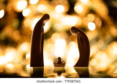 Christmas. Wooden crib with lights background.