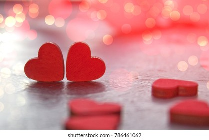 Valentine's Day greeting card. Two red hearts close up with copy space.