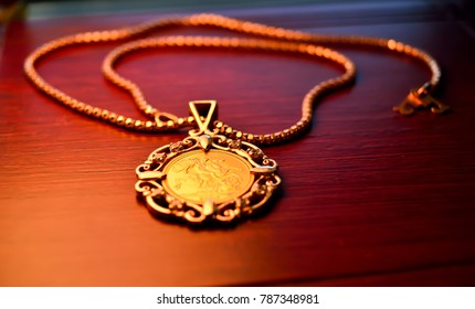 Gold sovereign coin as jewelry pendant on a chain