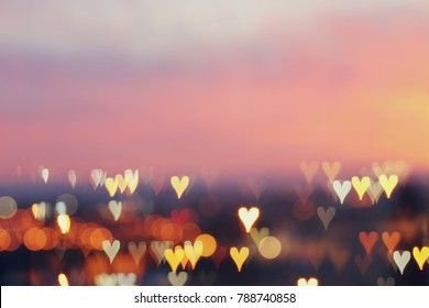 Valentine's day romantic glitter bokeh background with many hearts lights