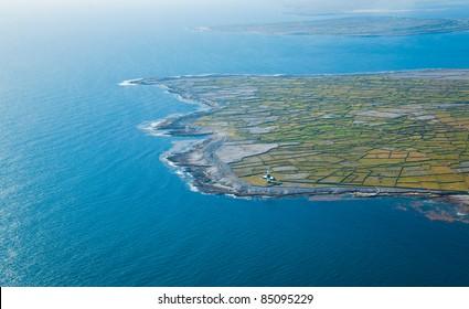 Aerial landscape of the lighthouse on Inisheer Island, part of Aran Islands, Ireland.