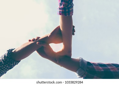 Image of 3 peoples teamwork joining hands together, white sky background,success and team work concept.