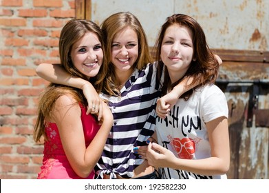 image of 3 young pretty female happy smiling teenage girl friends have fun in city outdoors portrait