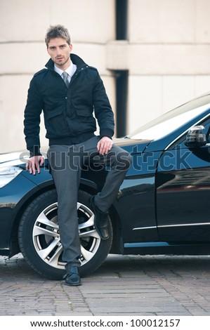 Young elegant man portrait with luxury car. #100012157