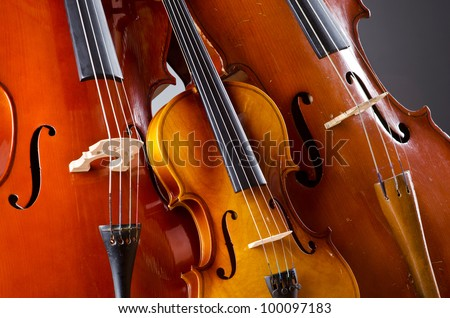 Music Cello in the dark room Royalty-Free Stock Photo #100097183