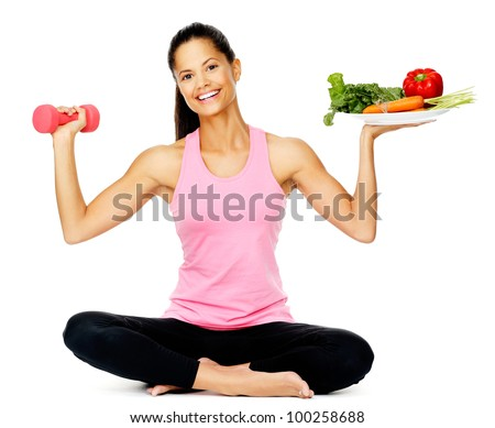 Portrait of a healthy woman with vegetables and dumbbells promoting a healthy fitness and eating lifestyle #100258688