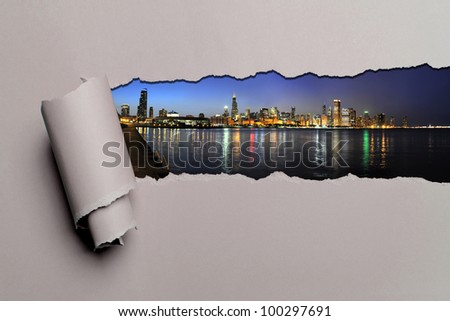 Torn paper with Chicago skyline at dusk