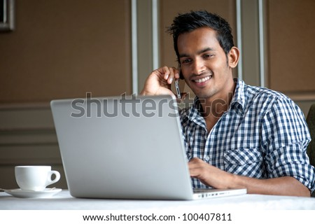 Attractive Asian Man in Cafe #100407811