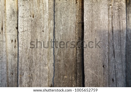 Grey vertical wooden dried planks as pattern #1005652759