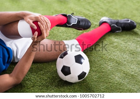 Close-up Of An Injured Male Soccer Player On Field #1005702712