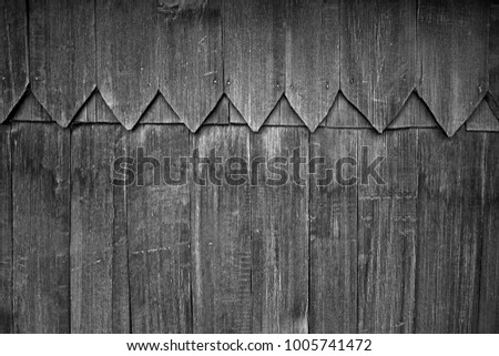Old plank wooden wall background. The texture of old wood. Weathered piece of wood. Image includes a effect the black and white tones. #1005741472