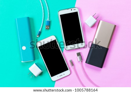 USB charging cables for smartphone and tablet in top view #1005788164