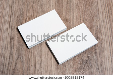 Blank business cards on wooden floor. High size mockup
