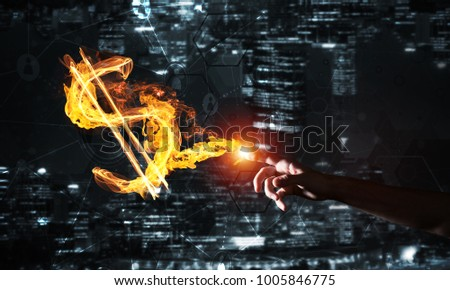 Fire glowing dollar sign on night city background #1005846775
