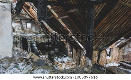 Old abandoned burnt cottage in Slovak winter countryside. #1005897616