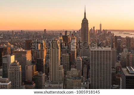 New York City, New York/ USA - October 31, 2017: New York City skyline and The Empire State building view during sunset from Top of the Rock #1005918145