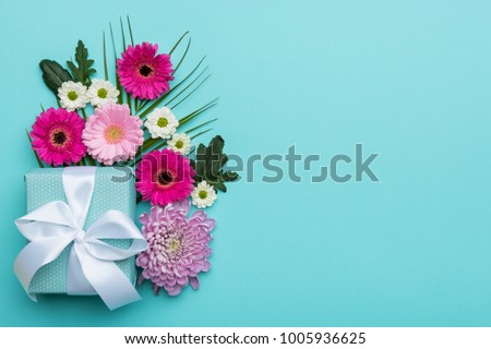 Happy Mother's Day, Women's Day, Valentine's Day or Birthday Pastel Candy Colors Background. Floral flat lay greeting card with beautifully wrapped present and copy space. #1005936625