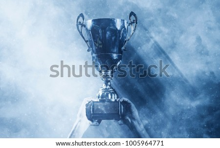 soccer players team group celebrating the victory and become champion of game while holding win coup Royalty-Free Stock Photo #1005964771