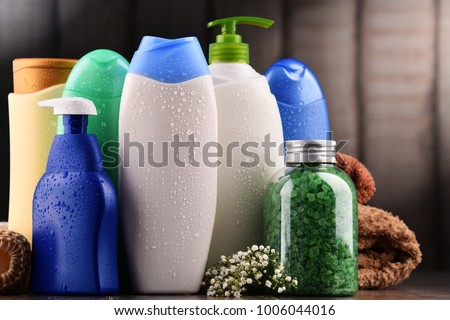 Plastic bottles of body care and beauty products. Royalty-Free Stock Photo #1006044016