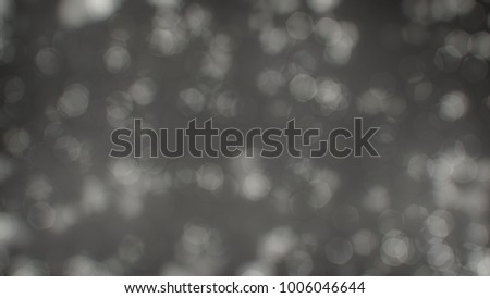 Bokeh abstract texture. Colorful. Defocused background. Blurred bright light. Circular points. #1006046644
