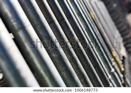 metal structures in a warehouse in stacks. metal supports for scaffolding and formwork. soft focus and bokeh.Outdoors storage of building materials and metal structures. #1006148773
