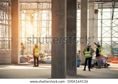 Group of construction engineer team in standard safety uniform work planing in construction site Royalty-Free Stock Photo #1006164136